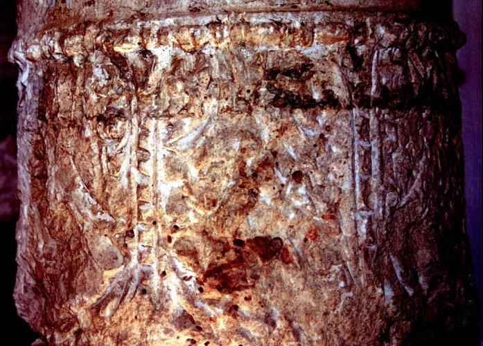 A close-up image of the menorah engravings on top of the column